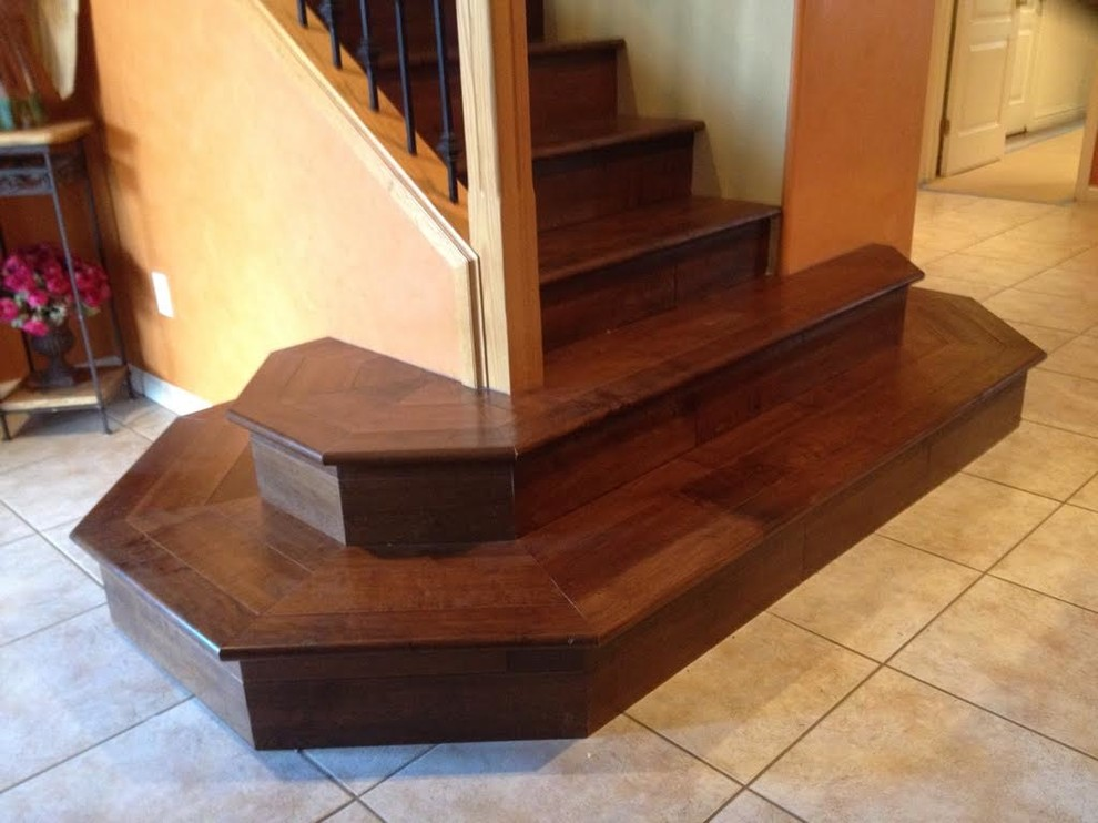 Staircase - small traditional wooden straight metal railing staircase idea in Los Angeles with wooden risers
