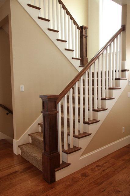 Inspiration for a mid-sized timeless carpeted u-shaped staircase remodel in Salt Lake City with carpeted risers