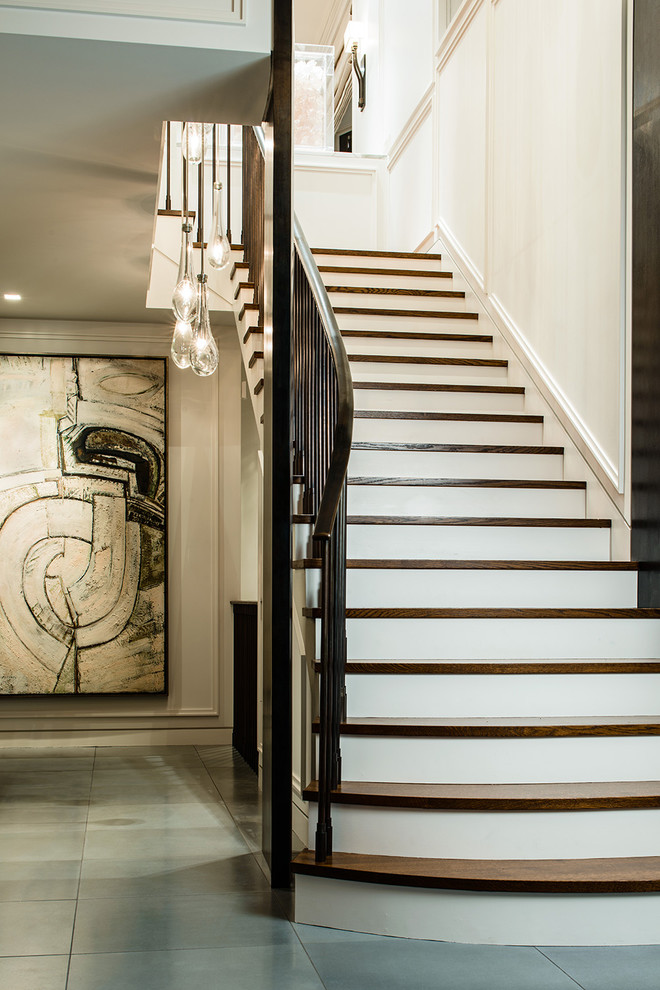 Example of a transitional wooden straight staircase design in Seattle with painted risers