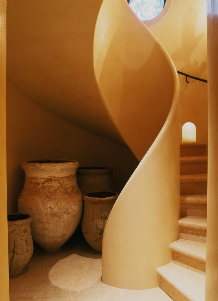 Inspiration for a mediterranean curved staircase remodel in San Francisco