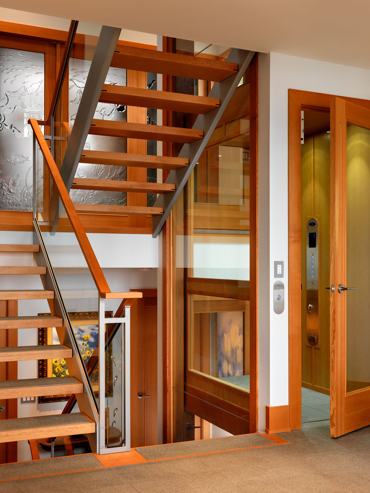 Example of a trendy open staircase design in Vancouver