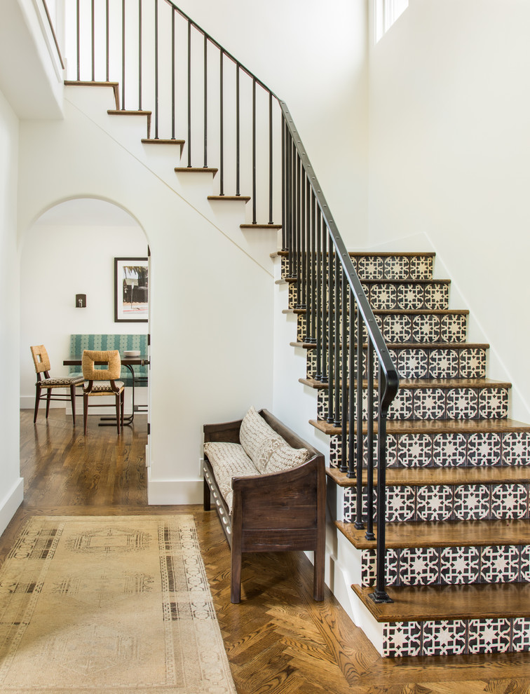 Staircase - mediterranean wooden l-shaped metal railing staircase idea in San Francisco