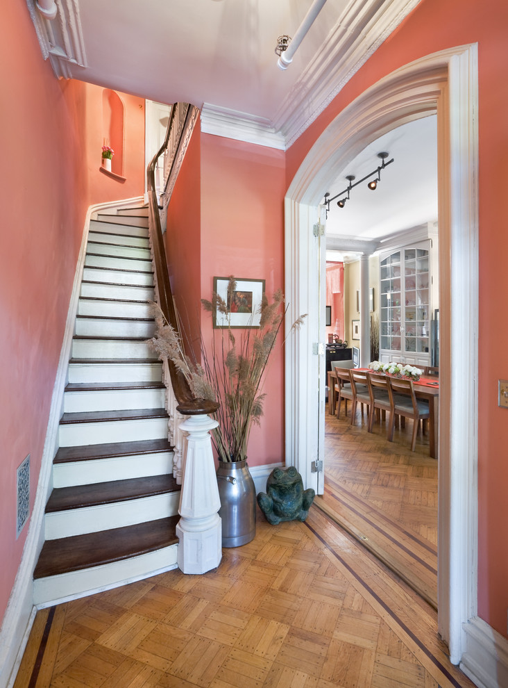 Inspiration for a small timeless wooden curved staircase remodel in New York