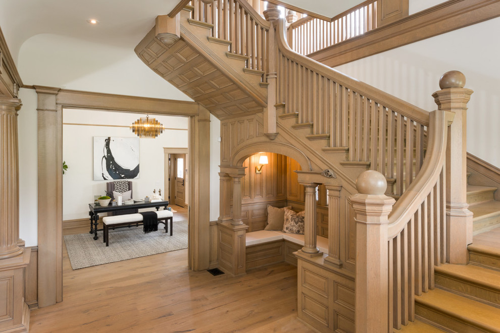 Inspiration for a timeless wooden u-shaped wood railing staircase remodel in Los Angeles with wooden risers