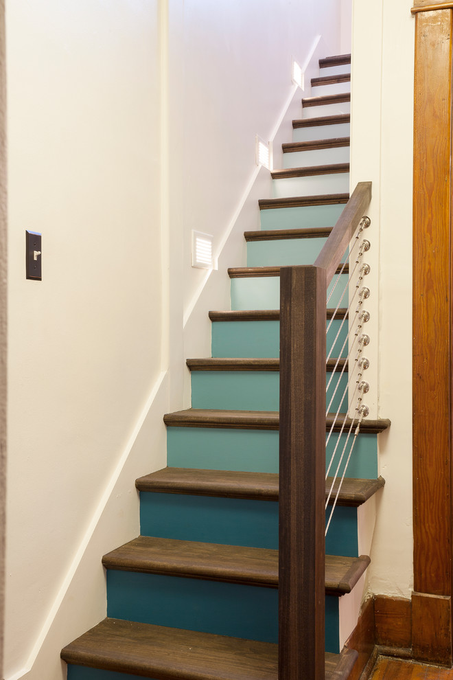 Staircase - small eclectic wooden straight staircase idea in Nashville with painted risers