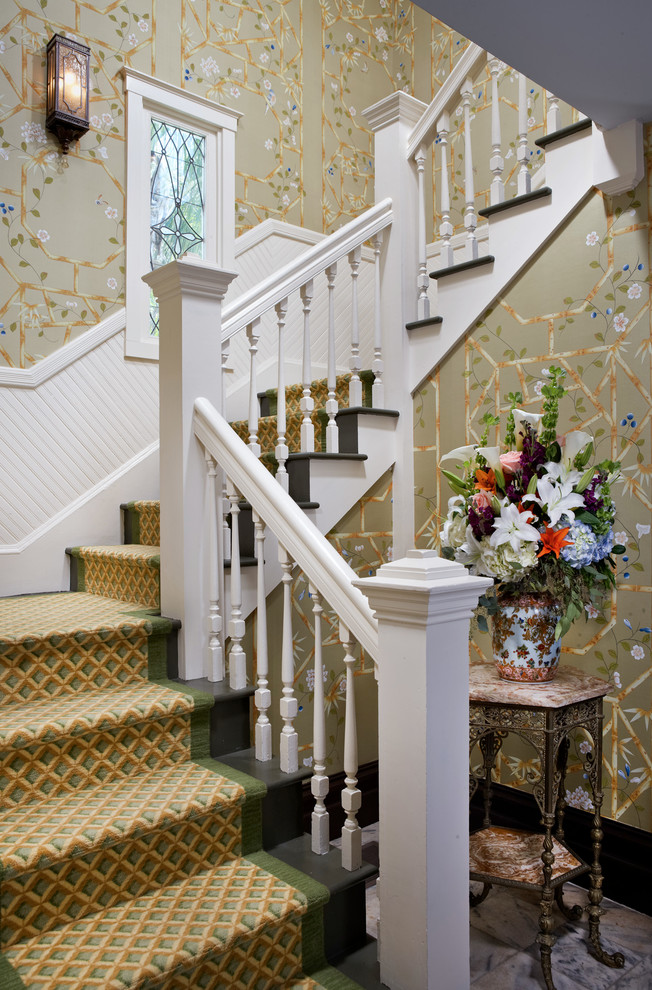 Staircase - traditional painted u-shaped staircase idea in Other with painted risers
