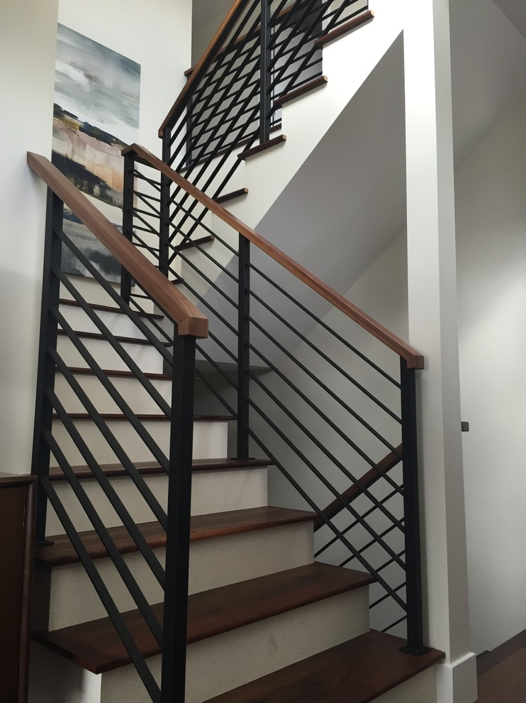 Inspiration for a mid-sized contemporary wooden u-shaped staircase remodel in Calgary with painted risers
