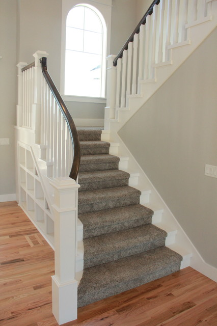Example of an arts and crafts staircase design in Other