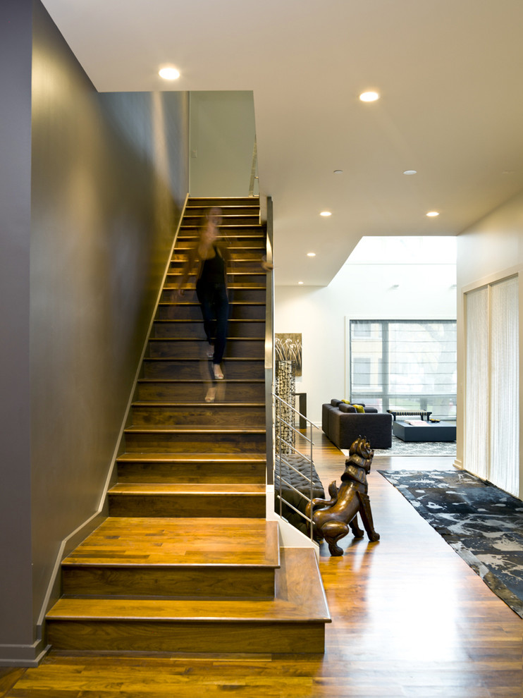 Inspiration for a contemporary wooden straight staircase remodel in Chicago with wooden risers
