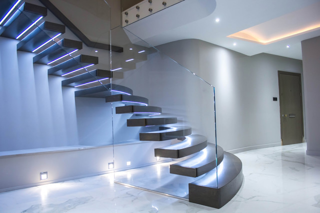 Illuminated Floating Staircase With Huge Curved Treads Modern Staircase
