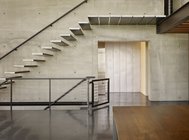 Inspiration for an industrial metal floating open staircase remodel in  Seattle