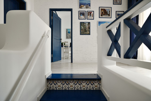 Inspiration for a mediterranean staircase remodel in Hong Kong with tile risers