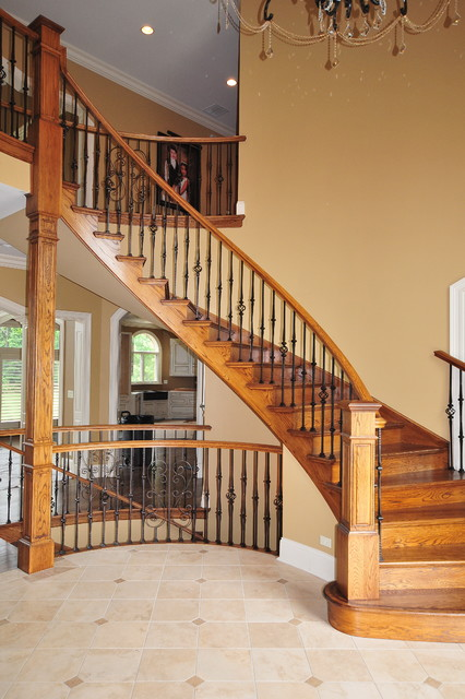 Attractive Example Of A Classic Wooden Curved Staircase Design In Chicago