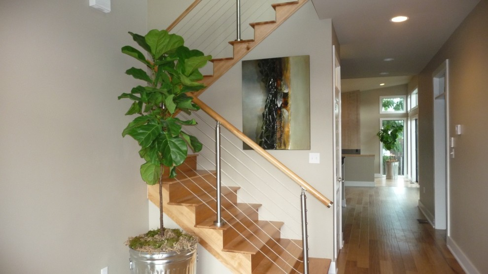 Trendy wooden u-shaped cable railing staircase photo in New Orleans with wooden risers