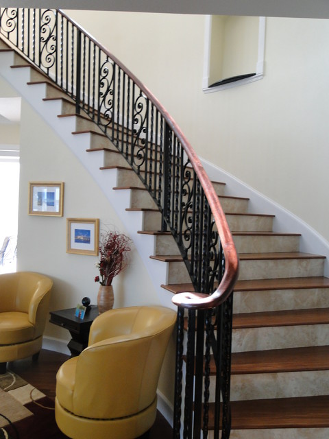 Interior wrought iron stair rail with lateral scroll ...