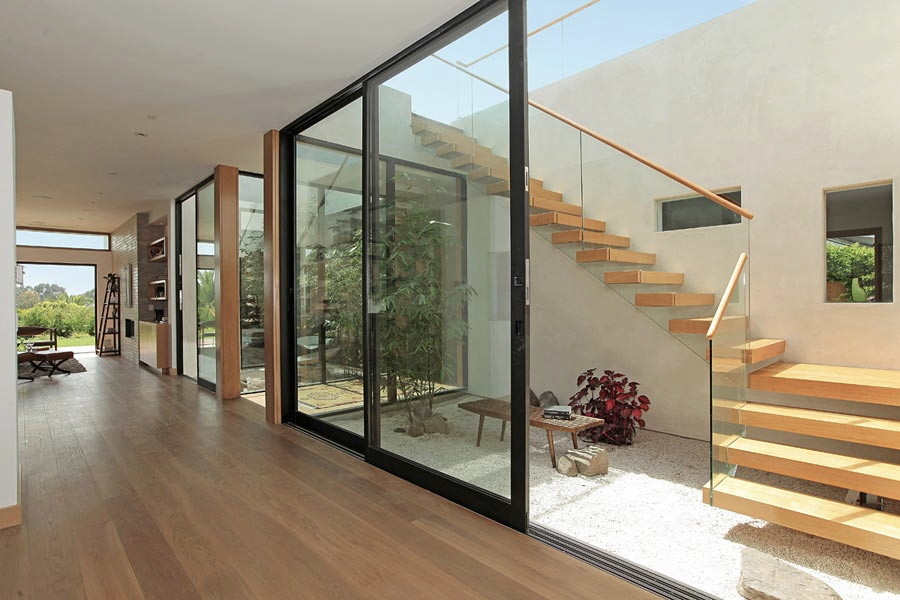 Staircase - mid-sized 1950s wooden straight open staircase idea in Los Angeles