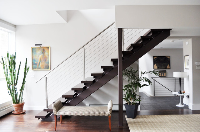 Trendy wooden straight open staircase photo in Portland Maine