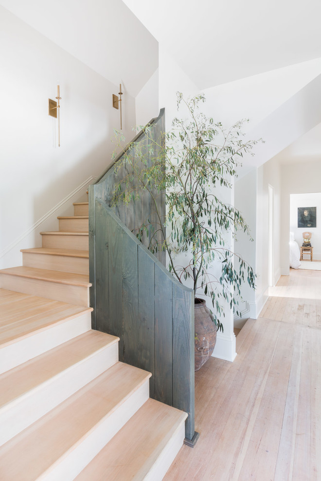 Example of a cottage wooden l-shaped wood railing staircase design in Portland with wooden risers