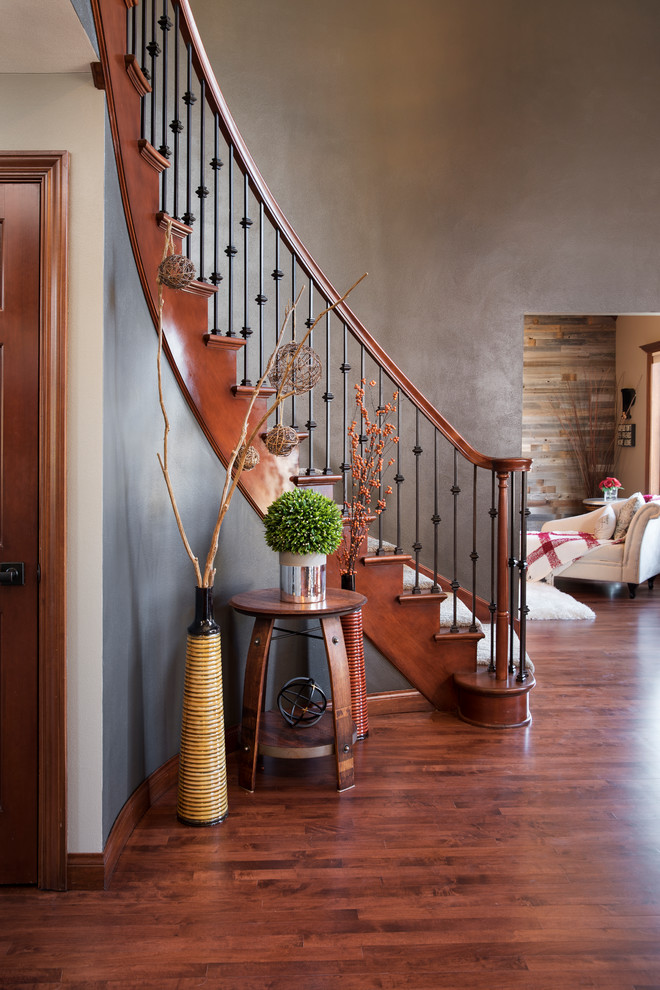 Inspiration for a mid-sized timeless wooden curved mixed material railing staircase remodel in Milwaukee with wooden risers