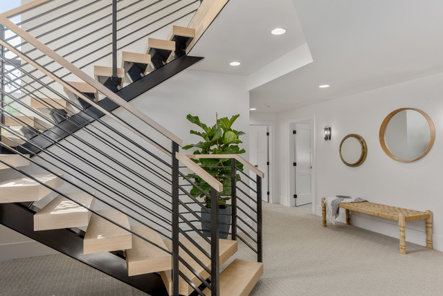 Staircase - large contemporary wooden u-shaped mixed material railing staircase idea in Salt Lake City with metal risers