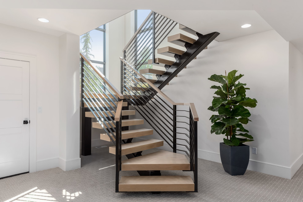 Large trendy wooden u-shaped mixed material railing staircase photo in Salt Lake City with metal risers