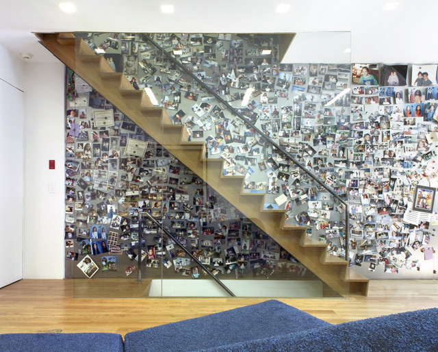 Example of an eclectic wooden straight staircase design in New York with wooden risers