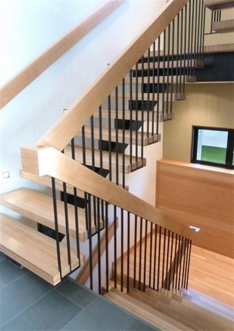 Mid-sized trendy wooden floating open staircase photo in Vancouver