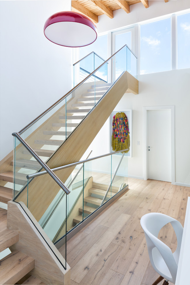 Example of a large beach style wooden l-shaped staircase design in Miami