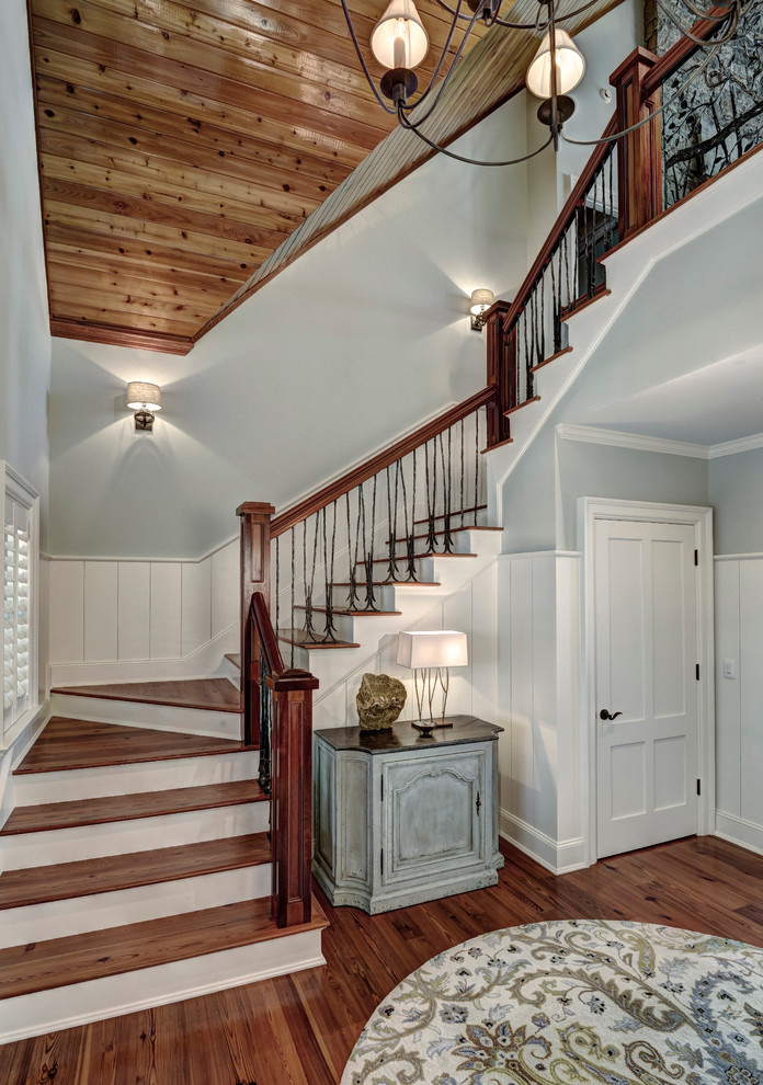 Staircase - mid-sized traditional wooden u-shaped mixed material railing staircase idea in Charleston with painted risers