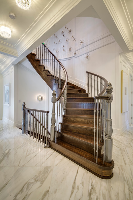 Inspiration for a large timeless wooden curved staircase remodel in Toronto with wooden risers