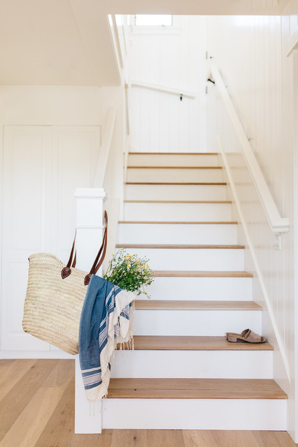 Staircase - beach style wooden l-shaped wood railing staircase idea in San Diego with wooden risers