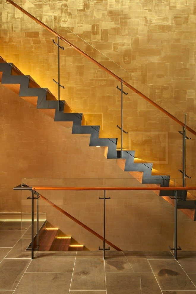 Staircase - modern wooden staircase idea in Seattle