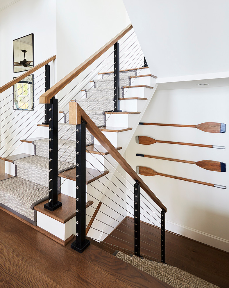 Beach style carpeted u-shaped cable railing staircase photo in Raleigh with carpeted risers