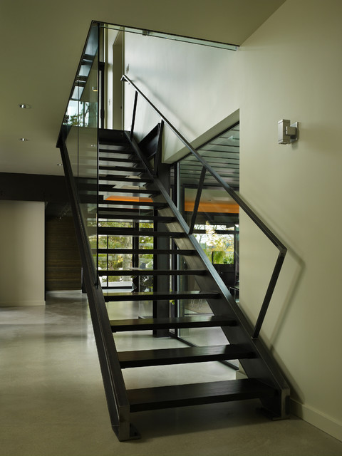 Minimalist open and glass railing staircase photo in Seattle