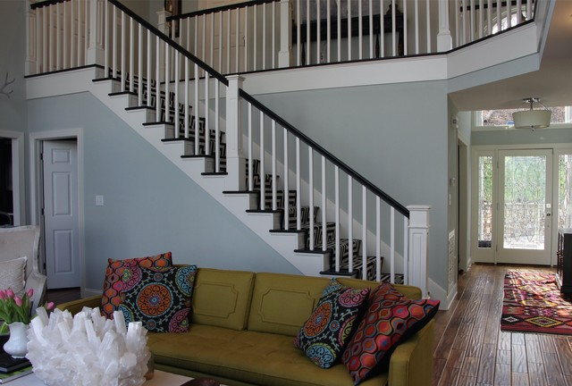 Example of a mid-sized eclectic staircase design in Other