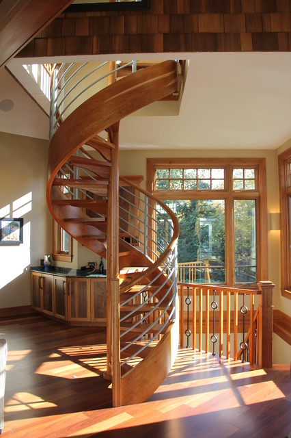 Example of a huge transitional wooden spiral open and mixed material railing staircase design in Boston