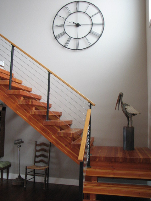 Large wall clock, cable railing, open glu-lam stairs contemporary-staircase
