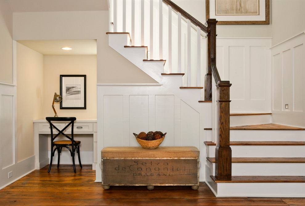 Inspiration for a mid-sized coastal wooden u-shaped staircase remodel in Charleston