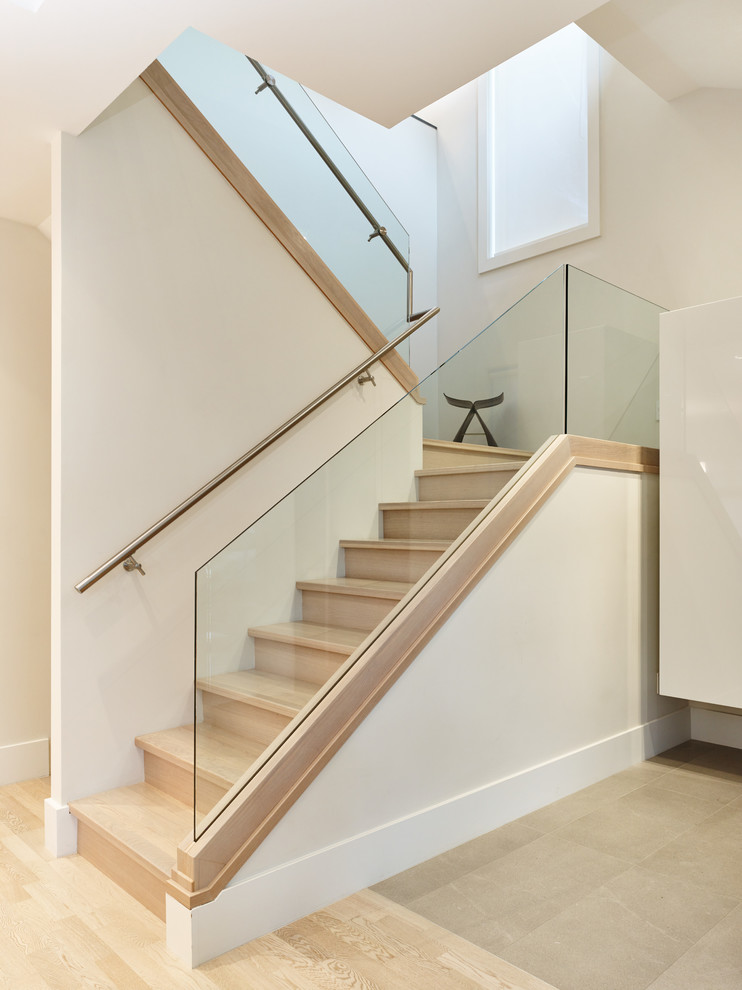 Trendy wooden u-shaped staircase photo in Vancouver with wooden risers