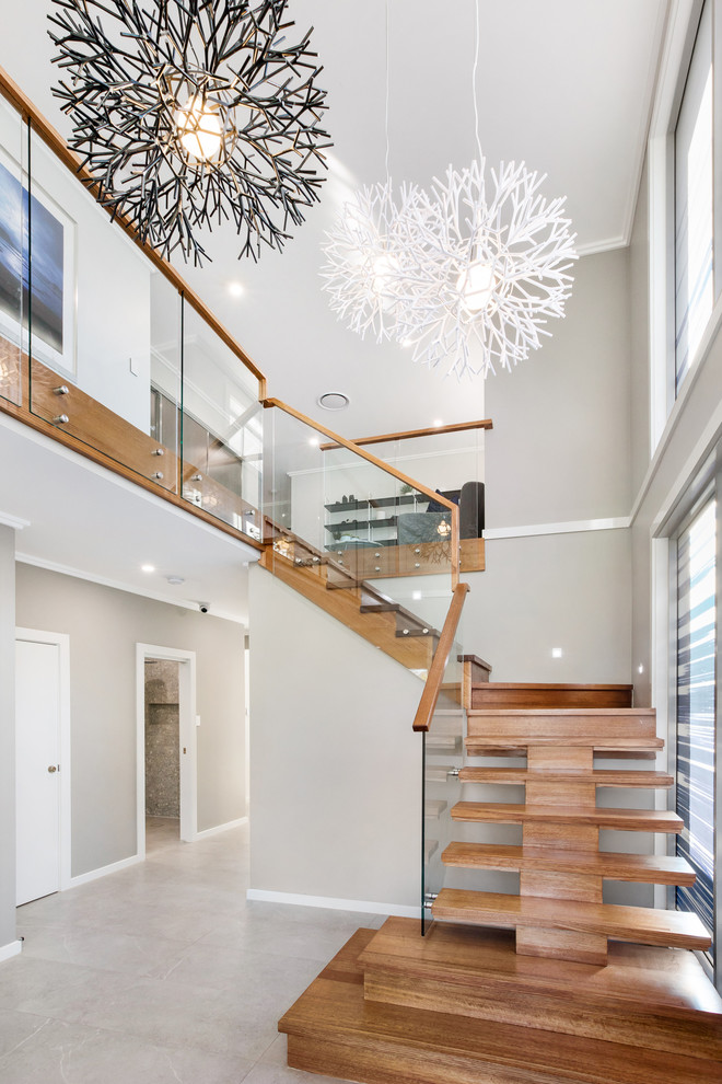 Photo of a contemporary wood l-shaped staircase in Sydney.