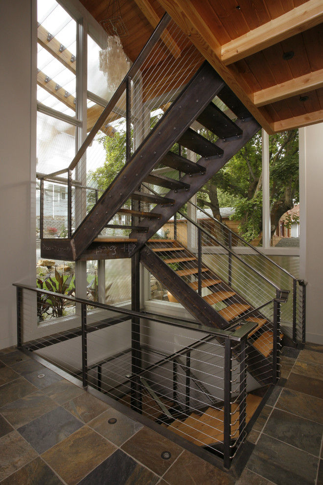Example of a mountain style floating staircase design in Seattle