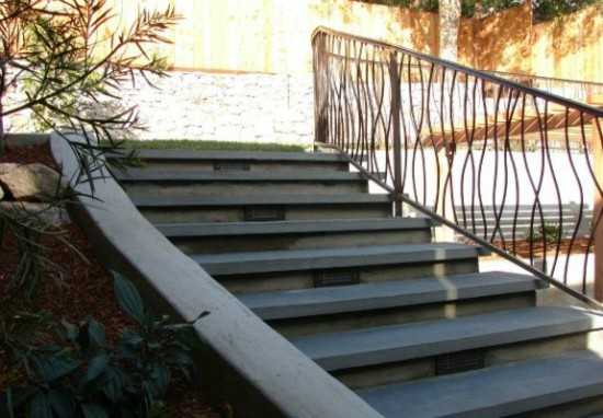 Lighted Stone Stairs And Custom Iron Handrail