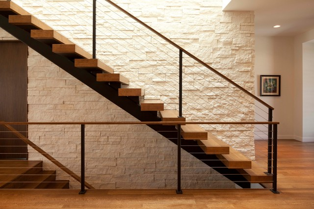 Minimalist wooden floating cable railing staircase photo in Minneapolis