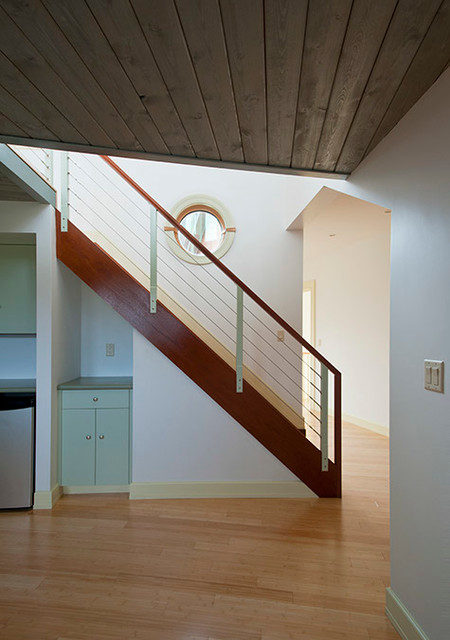 Mid-sized trendy wooden straight staircase photo in Boston with wooden risers