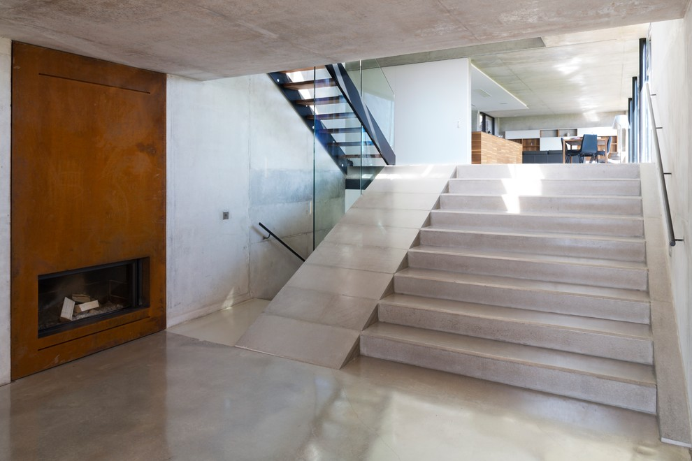 Inspiration for a mid-sized modern concrete straight staircase remodel in Cheshire with concrete risers