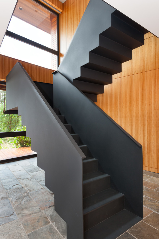 Staircase - large contemporary metal u-shaped metal railing staircase idea in Vancouver with metal risers