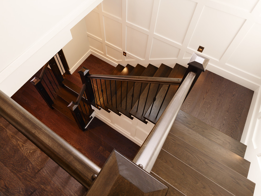 Example of a transitional wooden u-shaped staircase design in Vancouver with wooden risers