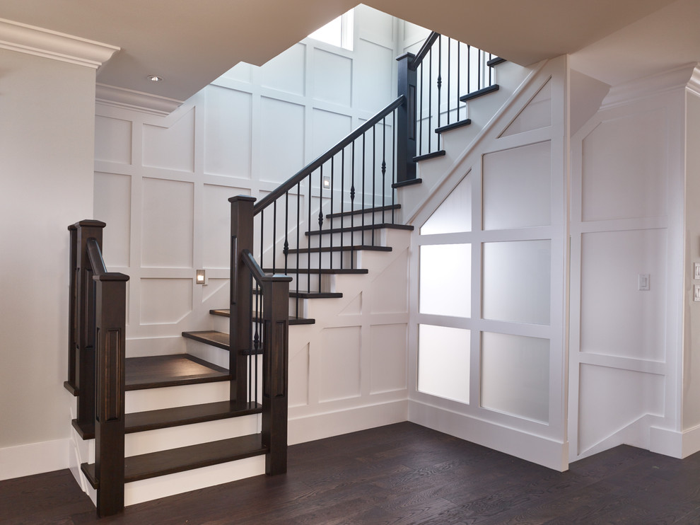 Inspiration for a transitional wooden u-shaped staircase remodel in Vancouver with wooden risers