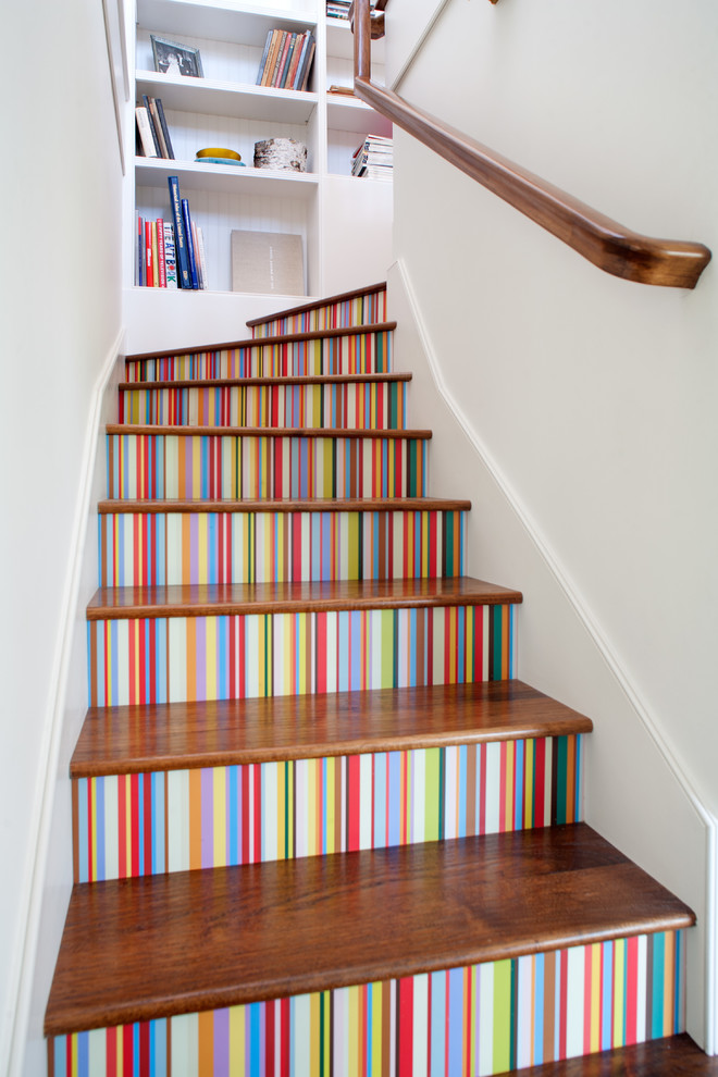 Eclectic wooden l-shaped staircase photo in Los Angeles with painted risers