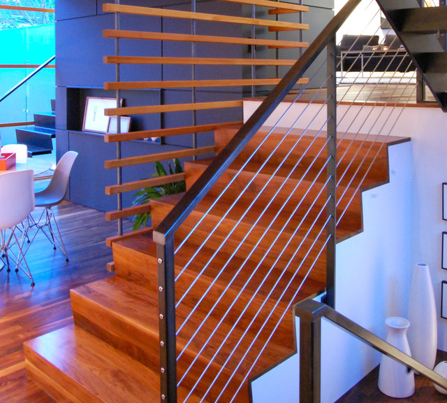 Main water fall and steel staircase with cable rails ...